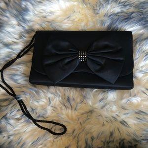 Handbags - Black satin clutch with bow